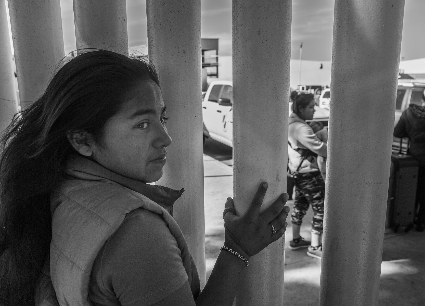 On the first day of the new Migrant Protection Protocols instituted by Homeland Security, on Jan. 25, 2019, Nya, foreground, who is from El Salvador, says goodbye to  Maria (background), who is also from El Salvador, as she gets into a van with her child, headed to San Diego for processing for possible entry into the United States. However, Maria may soon have to return to Mexico due a more stringent policy for obtaining asylum in the United States.