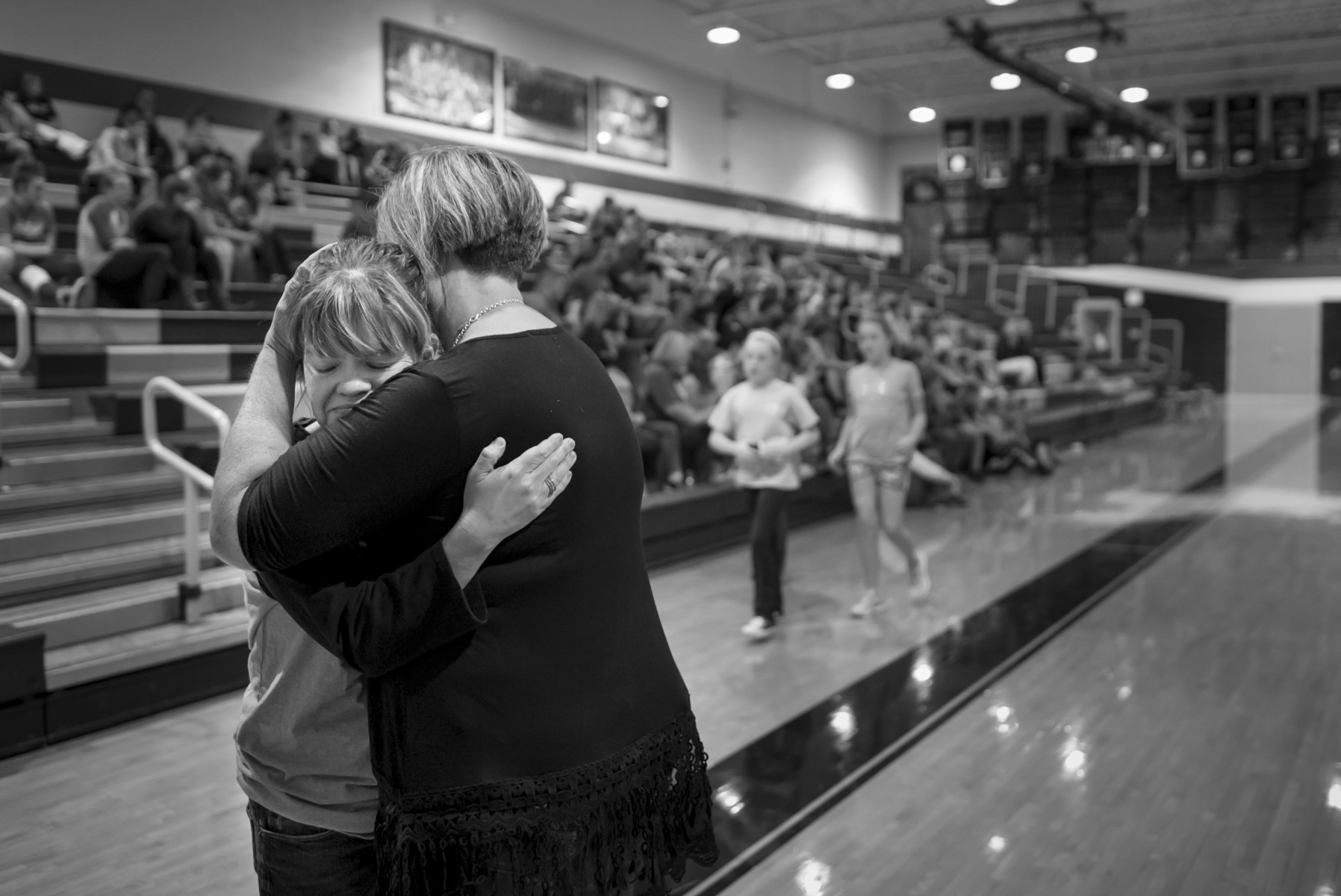 Melanie hugs her friend, Ronda Elam, after the screening of the movie A Girl Like Her, that shares the story of a bullying victim, hosted by Reagan's Voice Foundation at Clay County High School. Reagan's Voice Foundation is a nonprofit organization that was established by Melanie and a few of her close friends after Reagan's death. The organization helps spread Reagan's story and urges other victims of bullying to find a voice. As emotional as is it for Melanie to spread Reagan's story through the organization, such meetings are cathartic as well, especially when hosted at schools.
