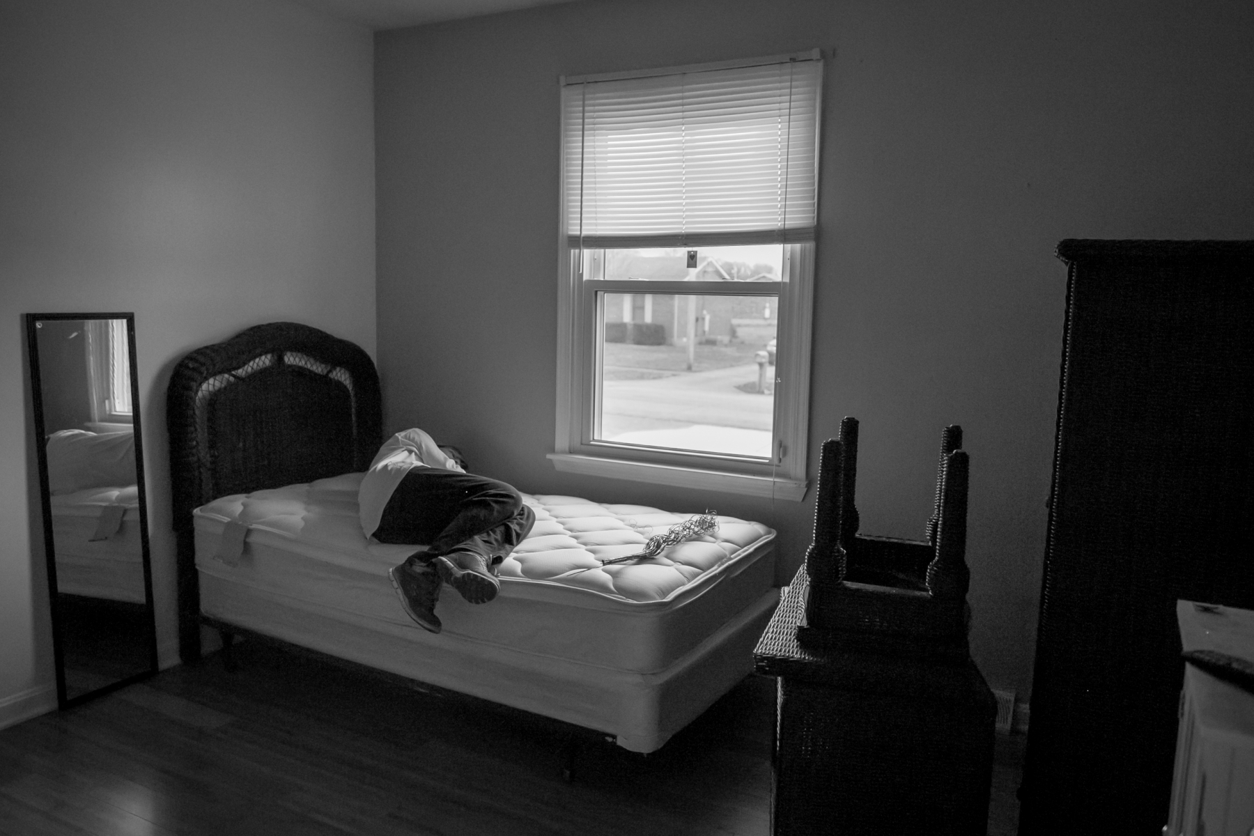 """Melanie lies on Reagan's bed one last time before the movers come to dismantle it to be moved to their new house in Cecelia, Kentucky. """"One of the things that I have clinged to was Reagan's room,"""" she says. """"Trying to keep it the same, walking by her door and even trying to convince myself that she was still in there or would be coming back. So to think about not having that is heartbreaking."""" Melanie is setting up a room for Reagan in her new house."""