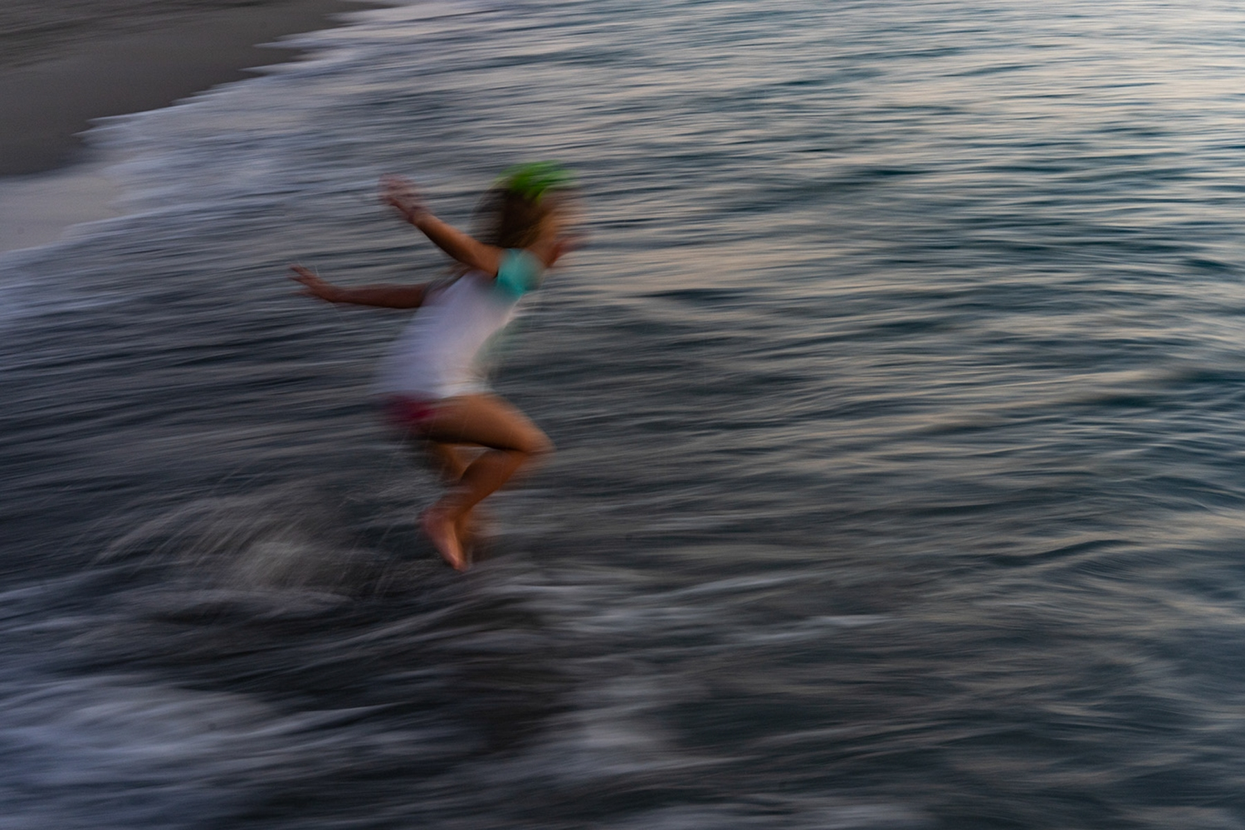 A young child plays at Venice beach Fla.