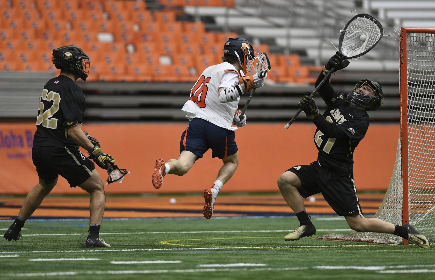 Army goalie Wyatt Schupler saves a shot by Syracuse's Brendan Curry during the game at the Carrier Dome on Feb. 23, 2020.