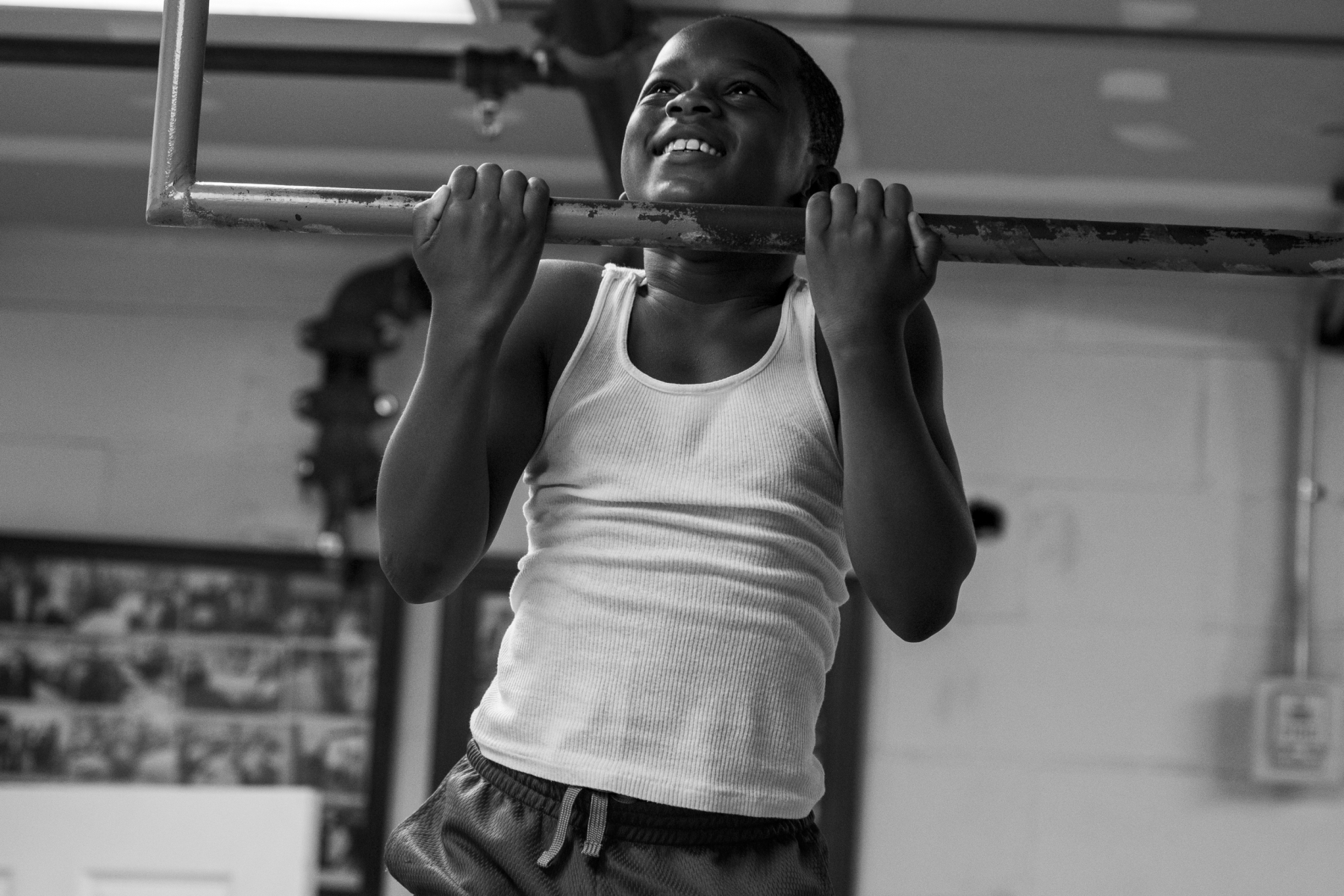 Da'vonne has been coming to classes at the gym since he was 4 years old. He and other boxers show off their pullups to on another during practice on Oct. 9.