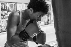 Elijah works at one of the heavy bags in the main room during practice on Oct. 9, 2019.