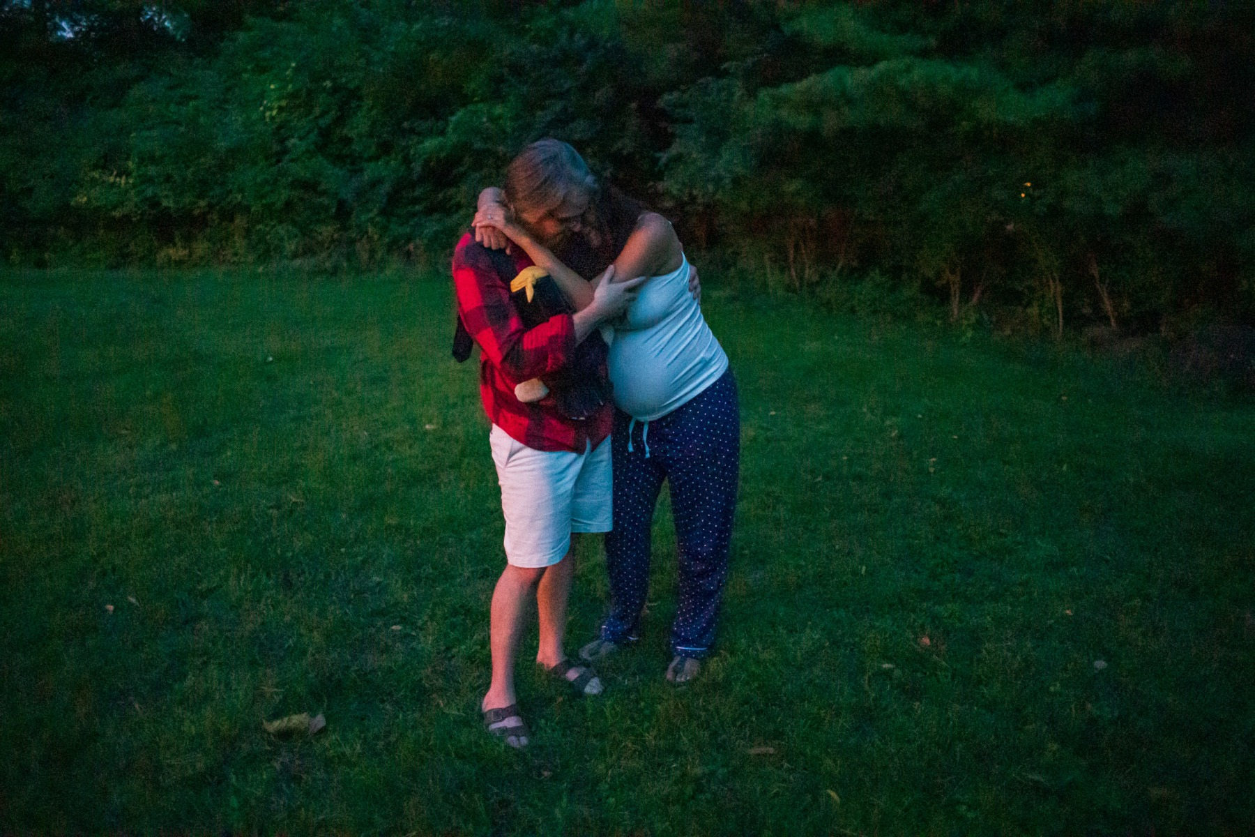 7:47pm - Seth supports his wife, Kate, through a strong contraction in their backyard in Columbus, Ohio. Their midwife encouraged Kate to walk around to help progress labor.