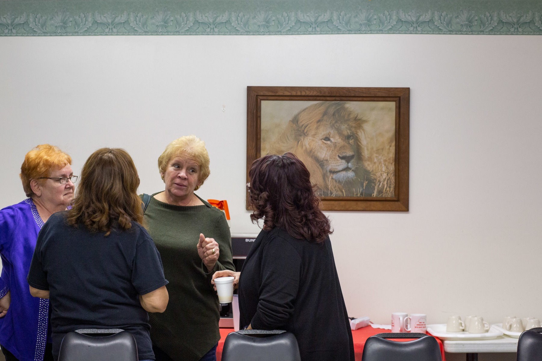 Kaye Hatzer, Denise Tate, Sue Hill, and Lori Norman chat over coffee and pancakes at the Chesterhill Lions Club Breakfast. Once a month, a steady crowd of current and former residents come together to reconnect and exchange stories with their family and neighbors.