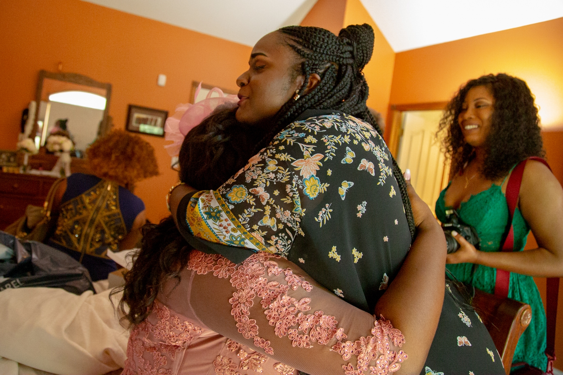 Pamela's friend from the Congo who is now studying in the US hugs Pamela as she prepares to walk down the aisle at her wedding in New Baltimore, Mich. In early 2018, Pamela met her now husband, Jordan, on a blind date to the movies.