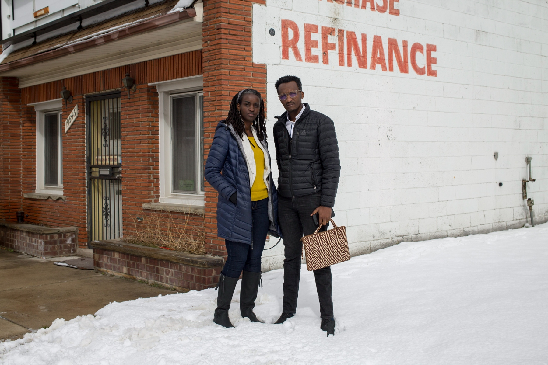 Mamba and Nadia stand on Grand River Avenue after Mamba gave a presentation about small business ownership to community members on March 2, 2018. Mamba and Nadia were eventually granted asylum in April 2017, four years after Nadia applied. Less than six months later, they won a $50,000 grant to open Detroit's first East African restaurant, Baobob Fare.