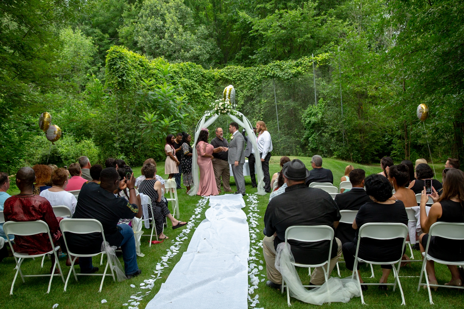 Pamela marries her partner, Jordan, at their wedding in the backyard of his family home in New Baltimore, Mich. Pamela's Congolese friends from Freedom House attended the ceremony, which was live-streamed for friends and family watching from Brazzaville.