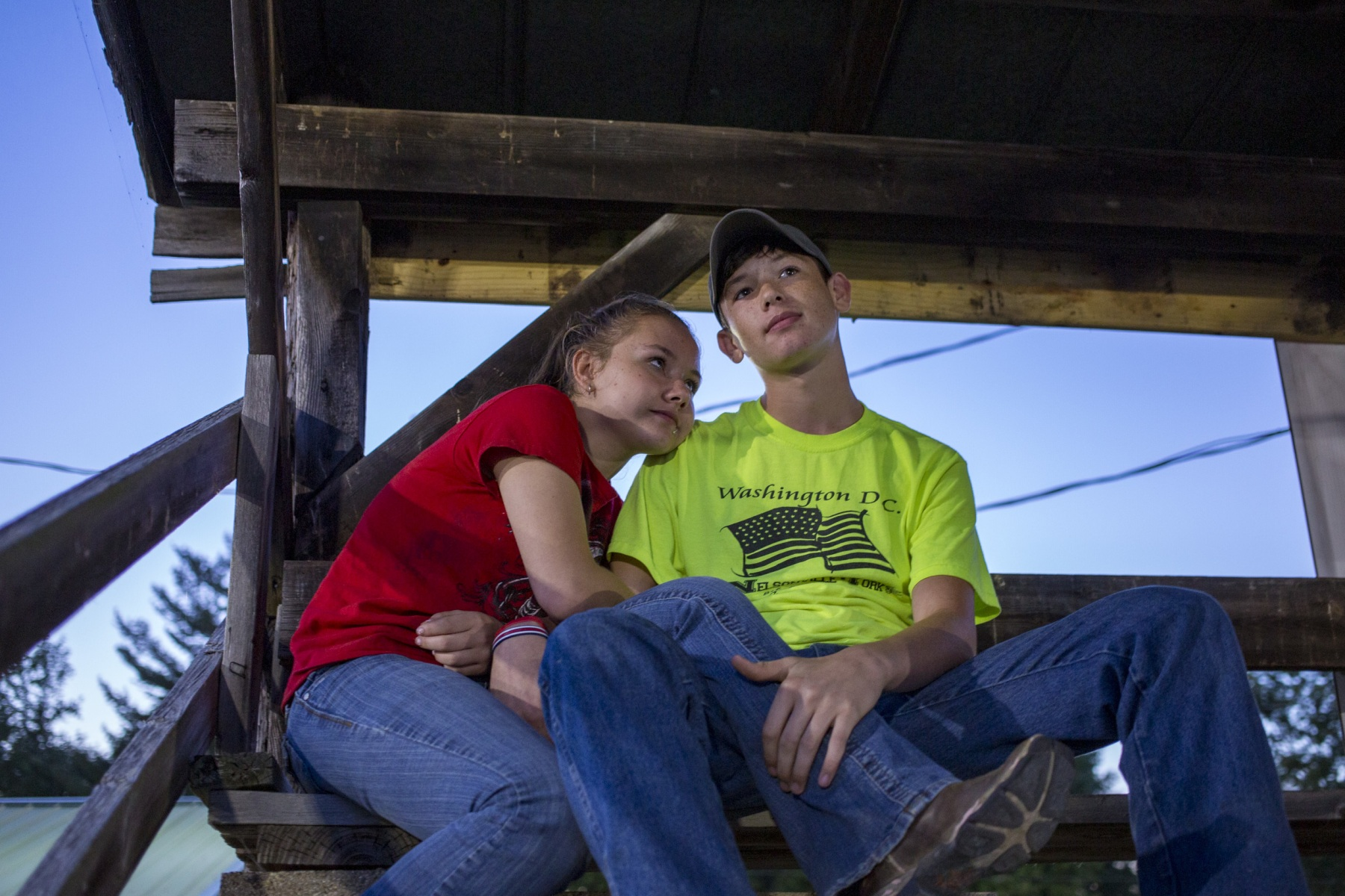 Desmond Norris, 16, and Ariel Rutter, 13, of Athens, Ohio sit on the empty bleachers of the horse arena at the Albany Independent Fair in Albany, Ohio on Saturday, September 7, 2019. The couple came to the fair for a date and found some quiet time while the crowded tractor and truck pull event occurred on the pulling track. (Photo by Lauren Santucci)