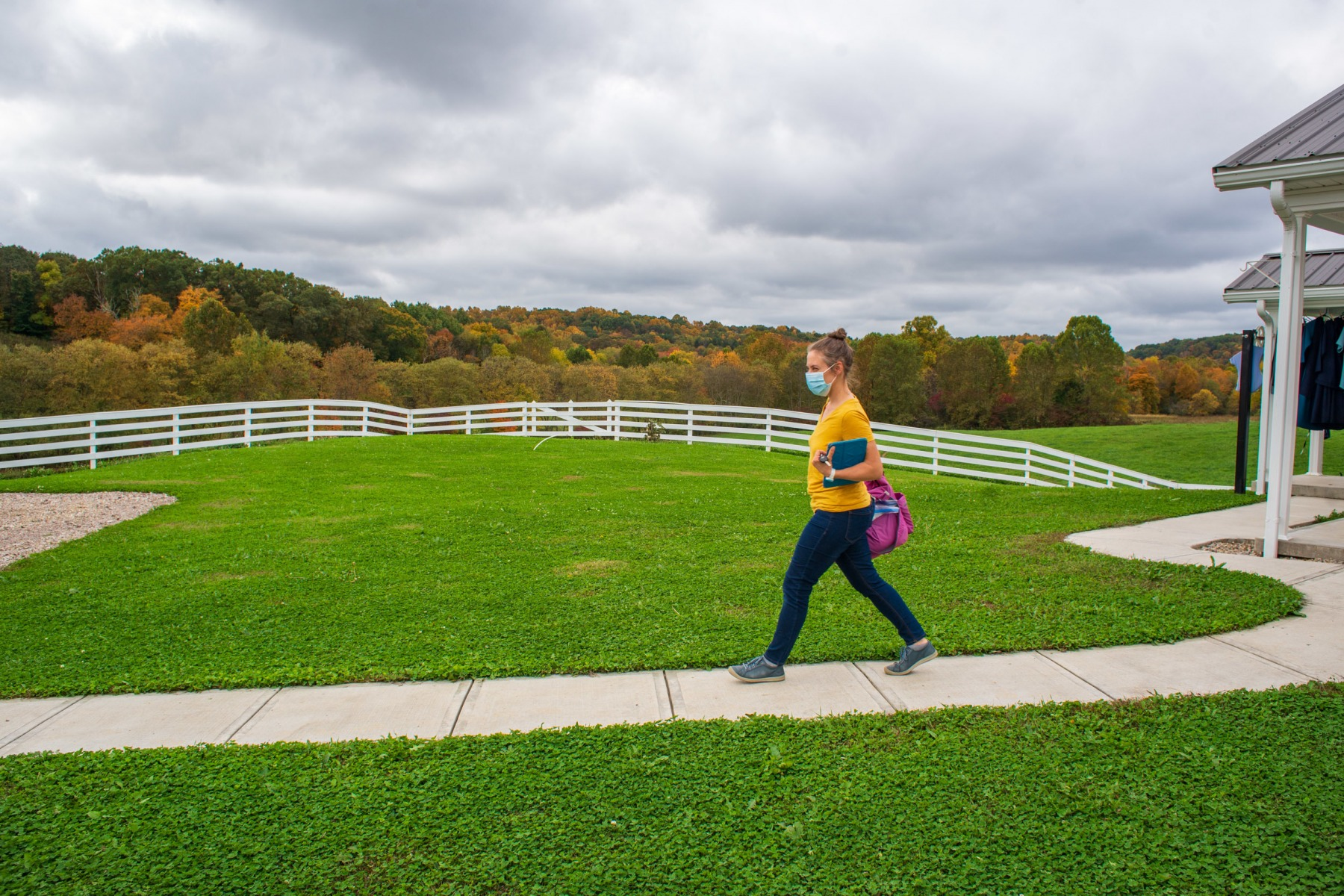 Lauren walks to her car after finishing a prenatal appointment with an Amish client in Hamden, Ohio.
