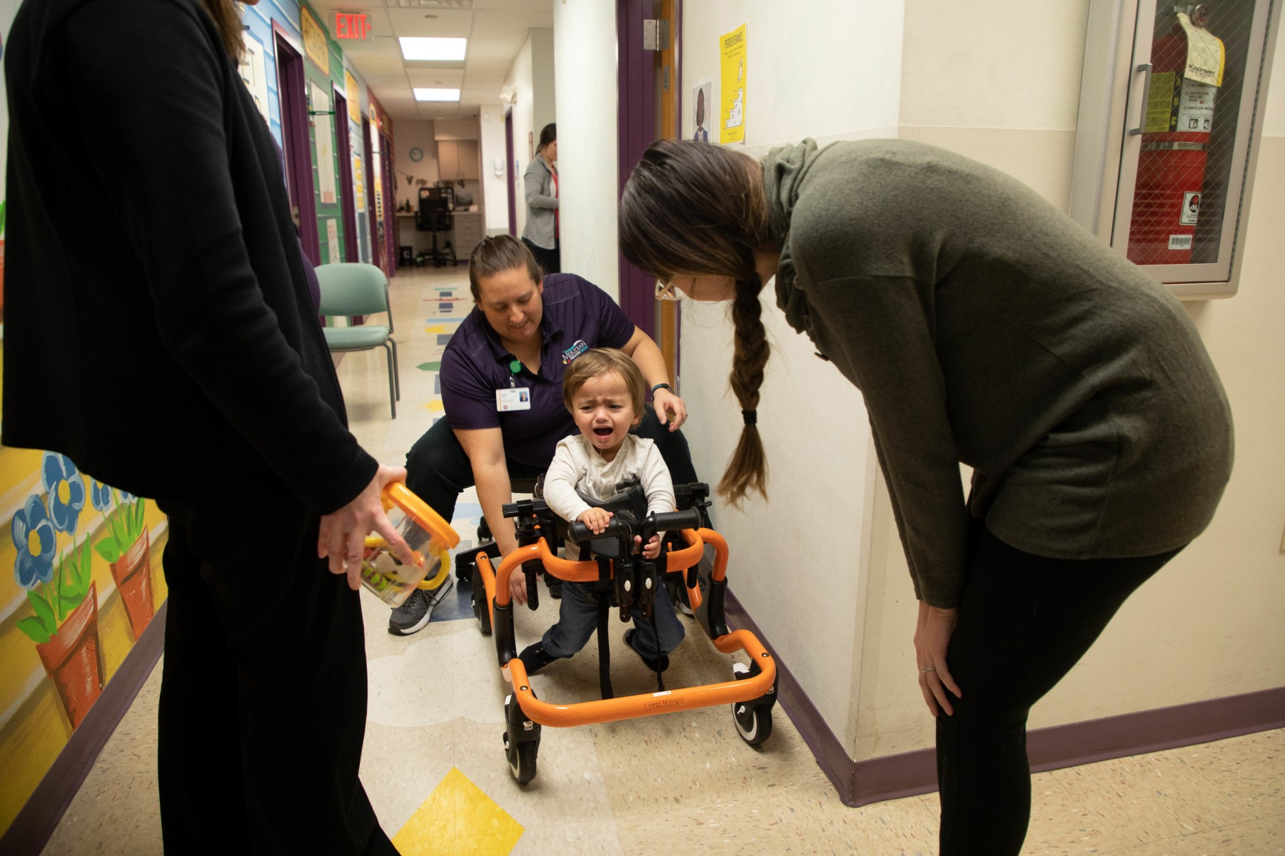 Kam throws a fit during therapy at Meridian Health Services in Muncie, Ind. Friday, Feb. 22, 2019. Kam visits Meridian twice a week to work on physical and cognative skills.