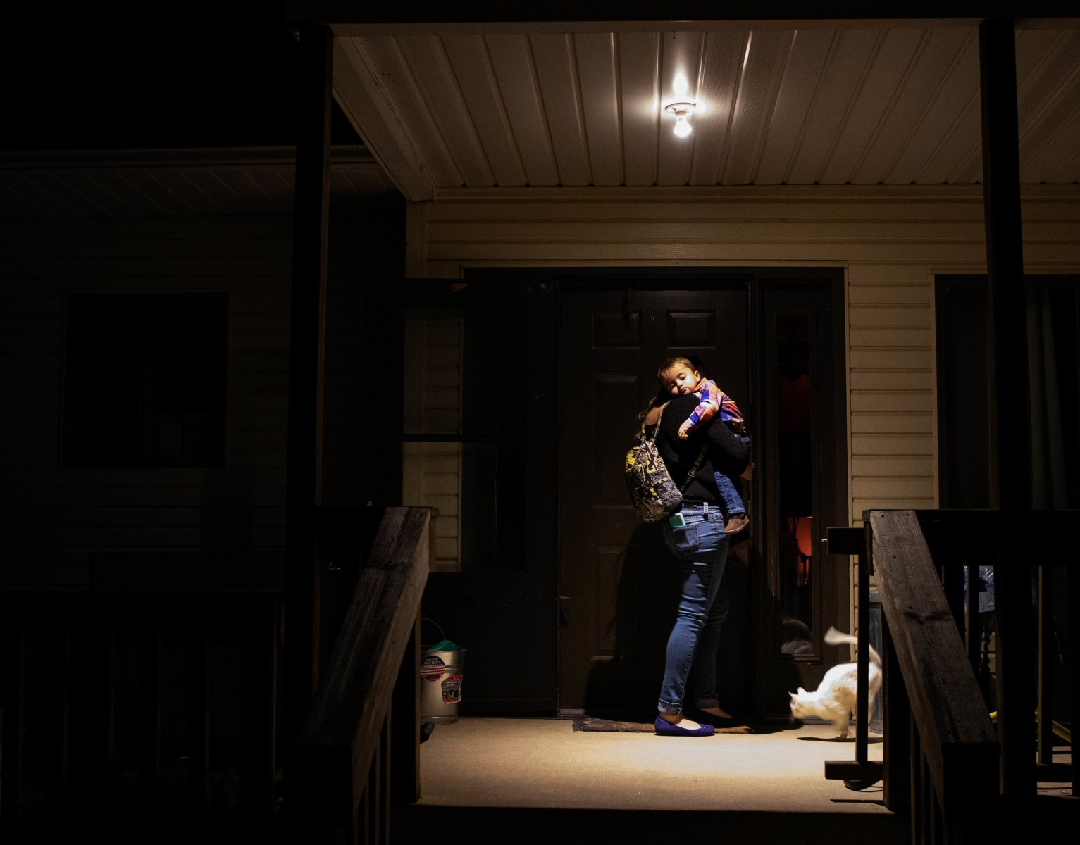 Amanda carries Kam into their house in Selma, Ind. Thursday, March 21, 2019, after speaking on a panel about Rare Diseases hosted by Ball State University.