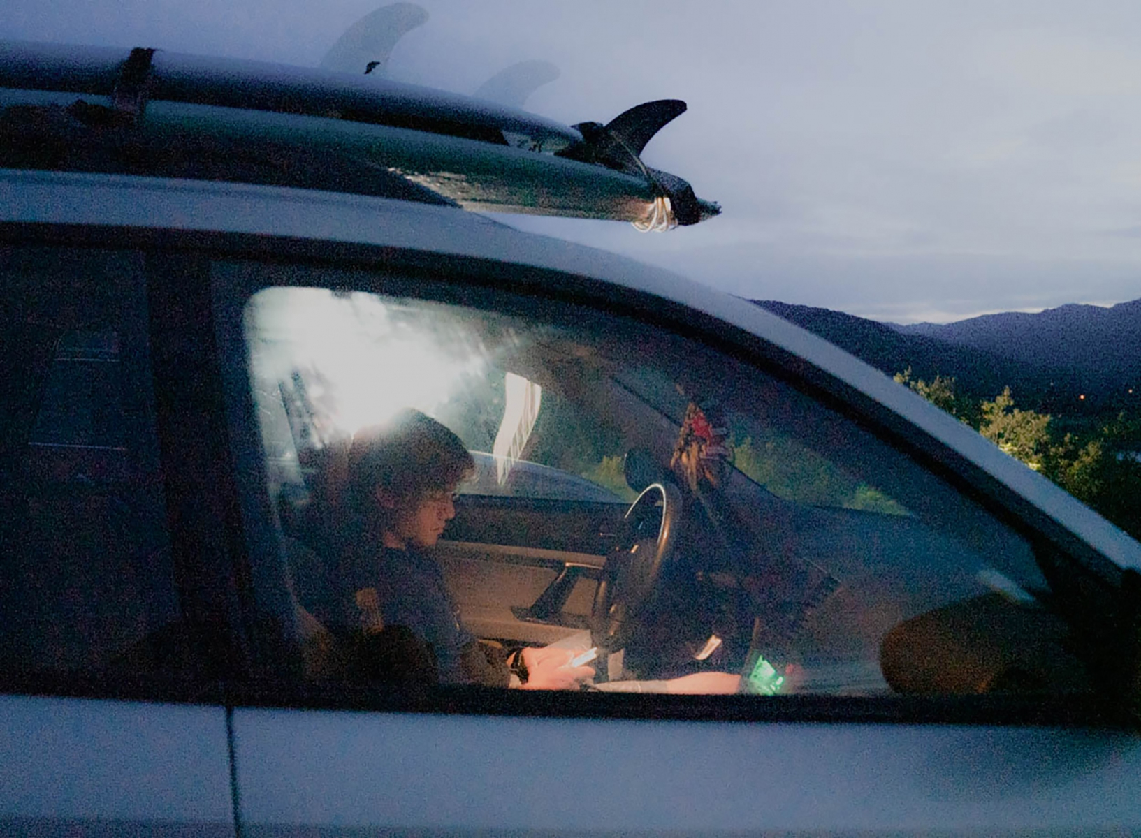 Mikey Goodman waits on Marine Hill with other local residents during a Tsunami Warning, Tuesday, July 21, 2020 in Kodiak, Alaska. Goodman received a call from his mother after surfing at the beach over an hour away from town, telling him to get to higher ground.
