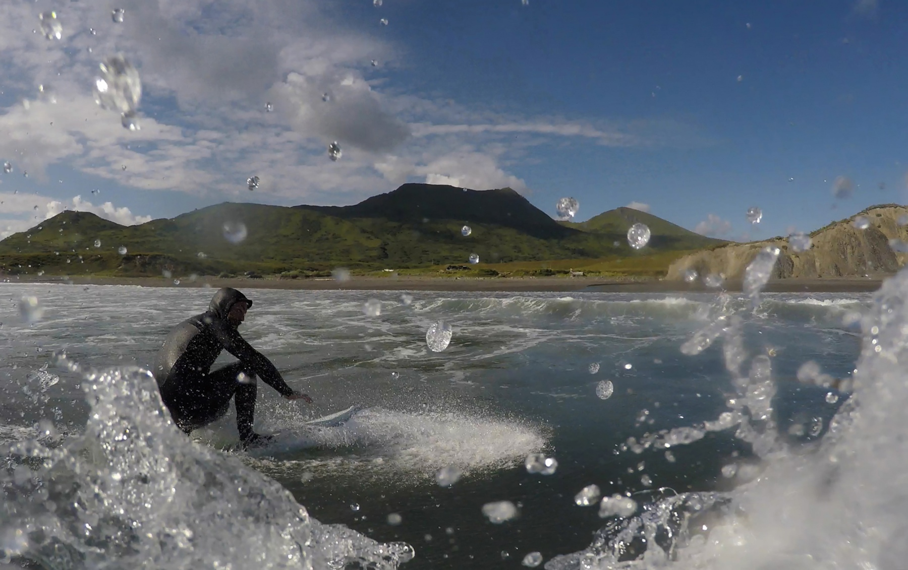 Scotty Russell surfs alone, Monday, July 27, 2020 at surfer's beach in Kodiak, Alaska. Russell surfs nearly every weekend he is off work. Peak surf season in Alaska is in the Fall and Spring when the waves are larger.