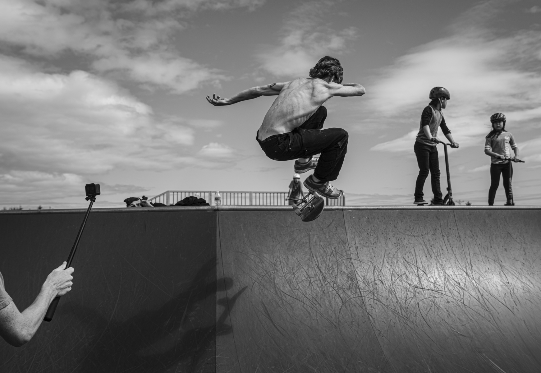 Brayden Stevens, 19, skates as his friend records him on a Gopro at Baranof Park, Thursday, August 6, 2020 in Kodiak, Alaska. Stevens is a well known skater in the community that can be found at the park nearly everyday of the summer when he's not working or surfing