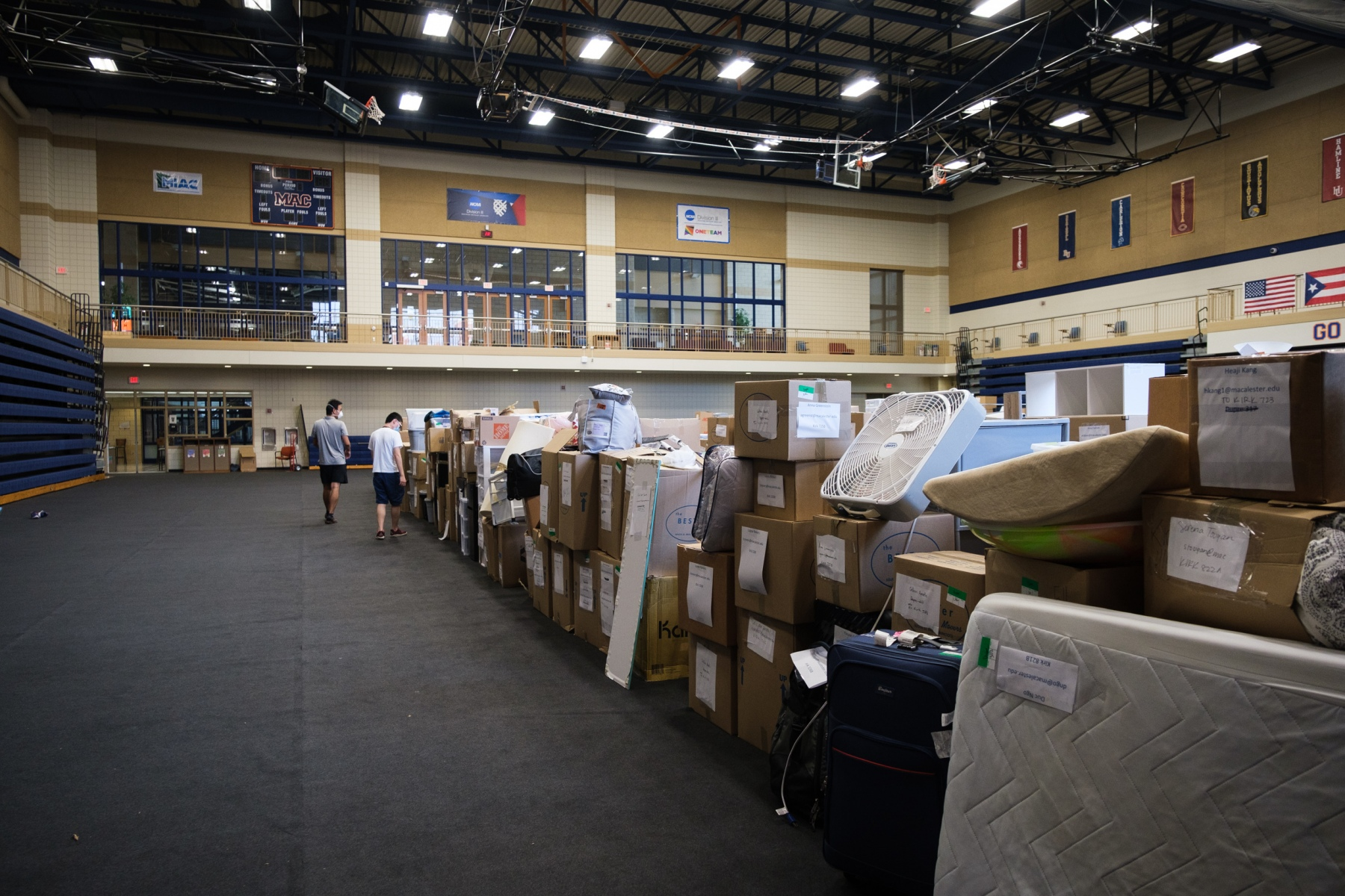 Students search for their belongings in the Leonard Center, where the packaged items of hundreds of students are currently stored after being removed from their dorm rooms over the summer. August 25, 2020.