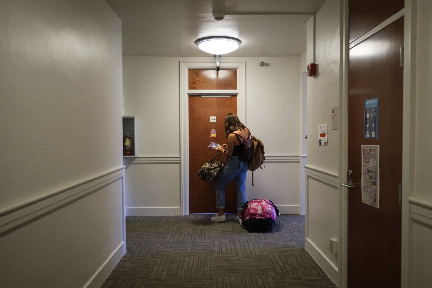 First year Rebecca Porter opens the door to her dorm room in Wallace Residence Hall for the first time on move-in day on August 26, 2020.