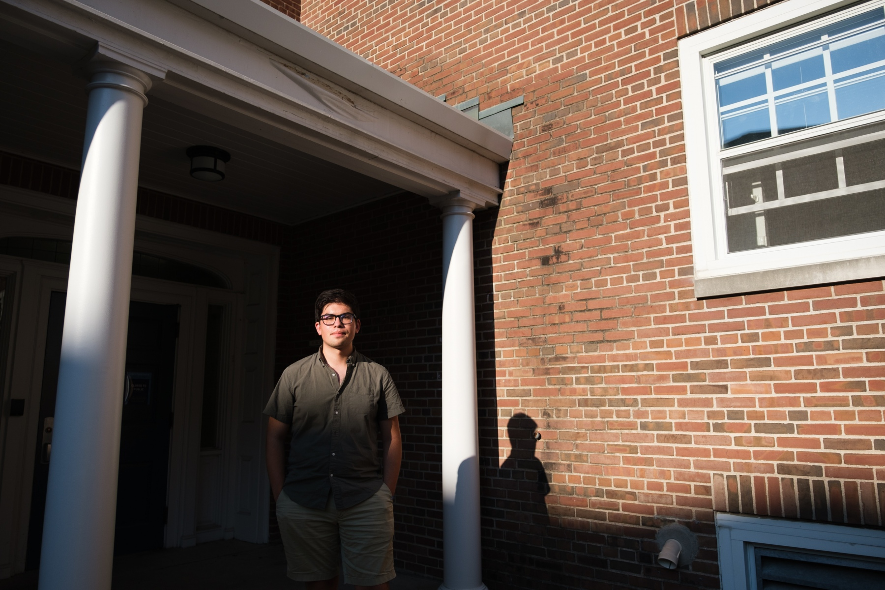 As summer ends, the Class of 2024 begins college amid a devastating pandemic and a national reckoning with systemic racism. Macalester first year Tyler Sanchez poses for a portrait outside Turck Residence Hall on August 28, 2020.