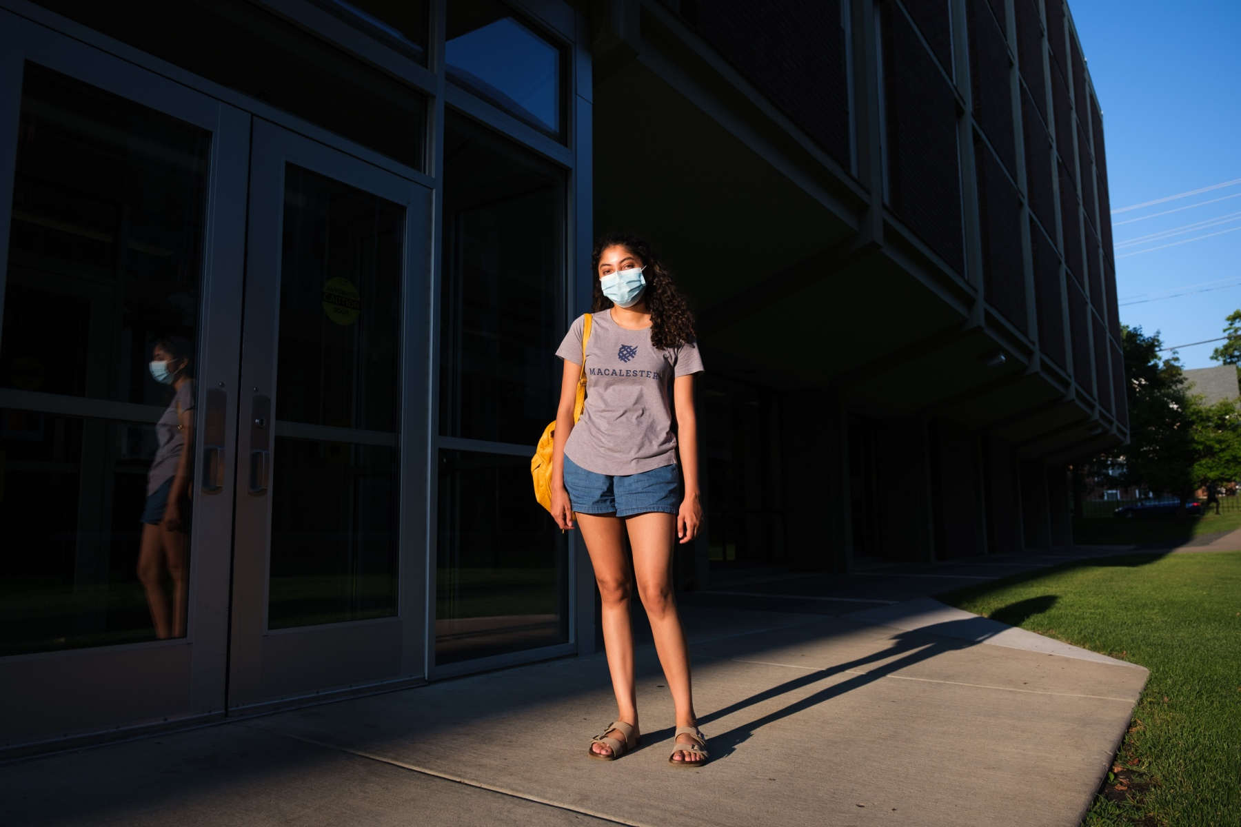 As summer ends, the Class of 2024 begins college amid a devastating pandemic and a national reckoning with systemic racism. Macalester first year Kamini Ramakrishna poses for a portrait outside Dupre Residence Hall on August 28, 2020.