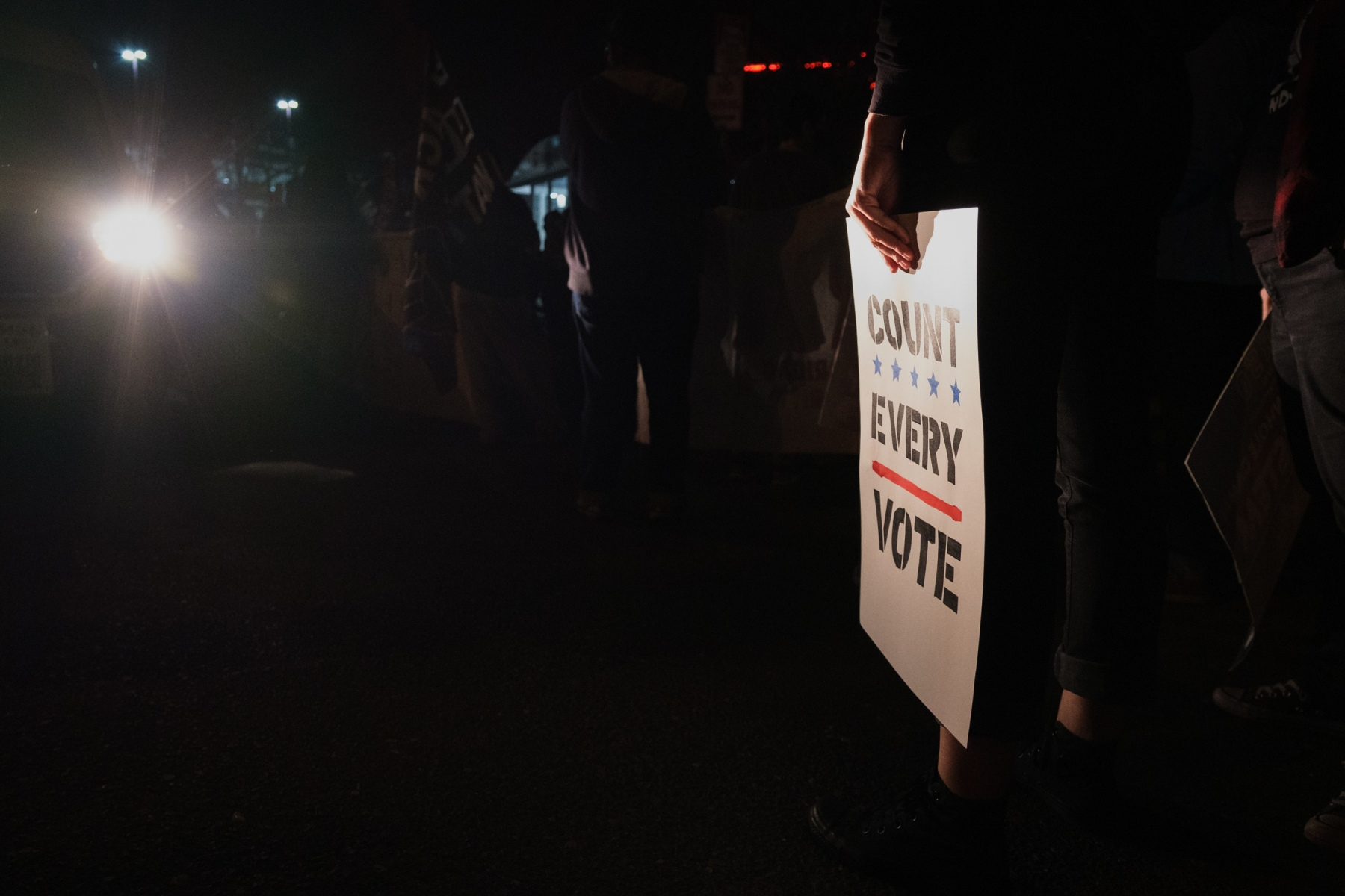 """A protestor holds a sign reading """"Count Every Vote"""" at a march to demand all votes be counted in the 2020 presidential election in Minneapolis on November 4, 2020, just one day after Election Day."""