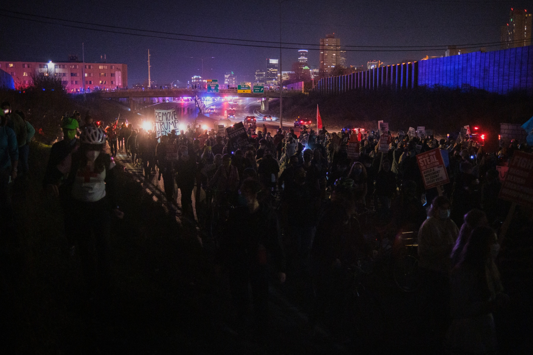 More than 600 protestors march down the highway through Minneapolis to demand all votes be counted in the 2020 presidential election on November 4, 2020, just one day after Election Day.