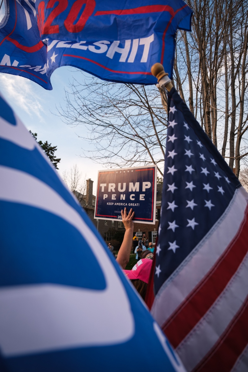 A supporter of President Trump holds a campaign sign at a rally to protest the president's loss outside Minnesota Governor Tim Walz's residence on November 7, 2020.