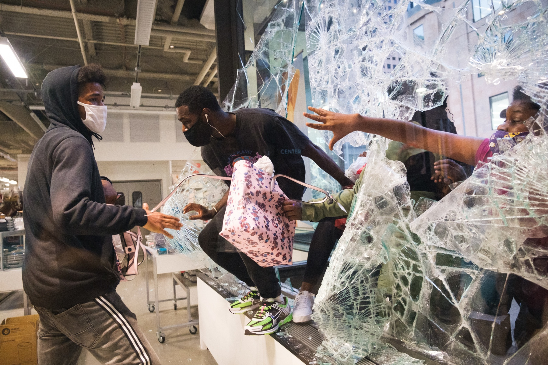 Bystanders begin breaking into and looting stores along Nicollet Avenue on August 26, 2020.