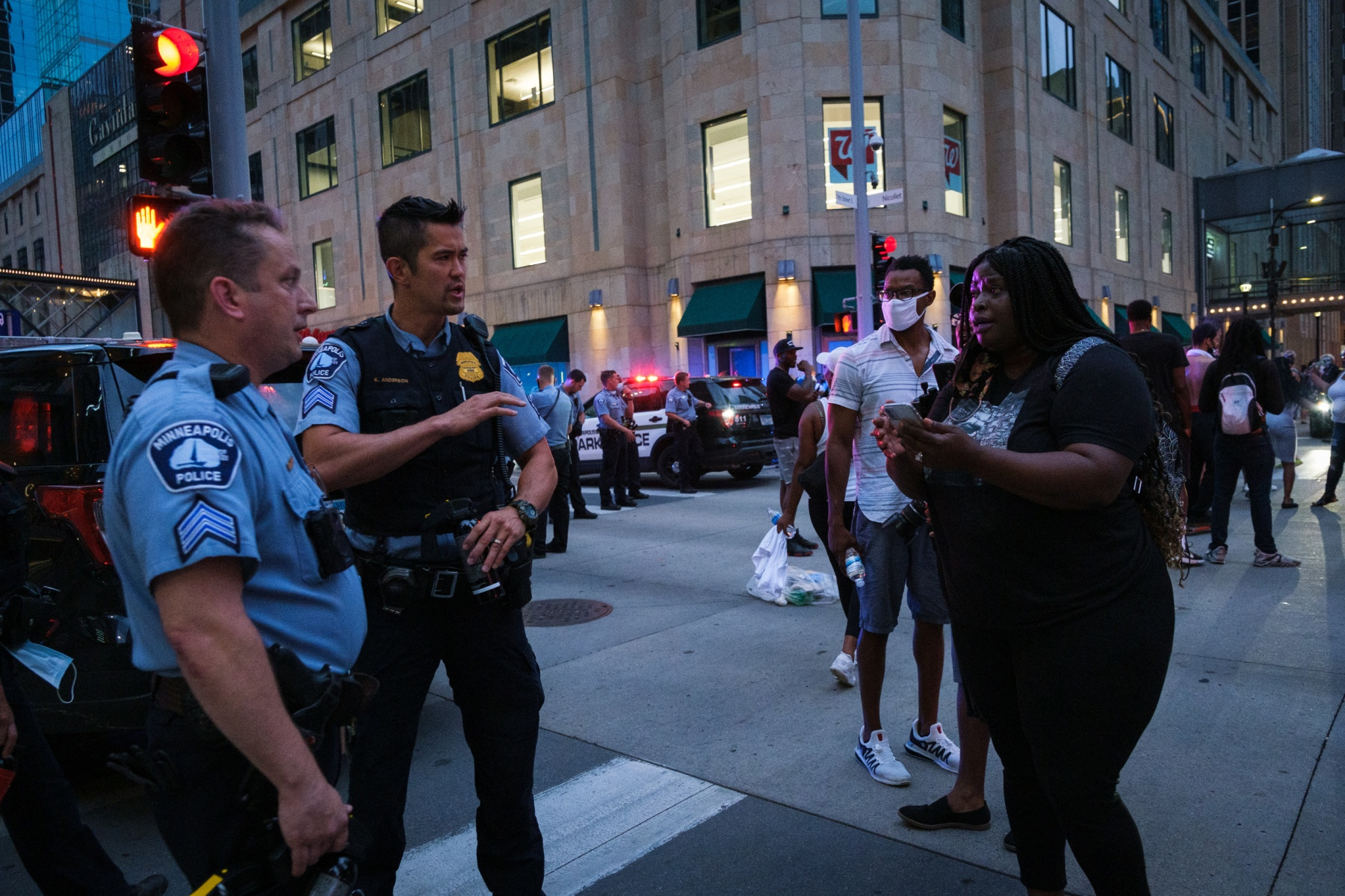 """Organizer and civil rights attorney Nekima Levy-Armstrong, who had earlier helped to circulate video showing the shooting was a suicide, asks to see the commanding officer on the scene on August 26, 2020. """"We're trying to help you guys,"""" she says."""