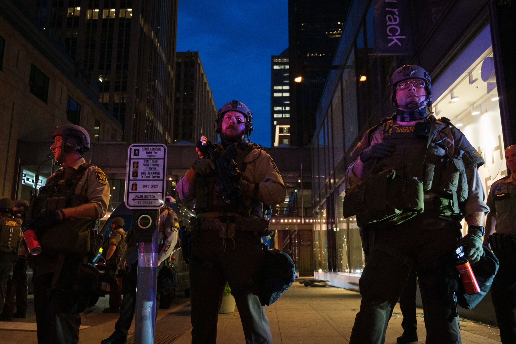 Sheriff's deputies stand on a street corner along Nicollet Avenue on August 26, 2020. As looting continues in the Nicollet Mall area, Minneapolis Mayor Jacob Frey issues a citywide curfew and Minnesota Governor Walz deploys the National Guard.