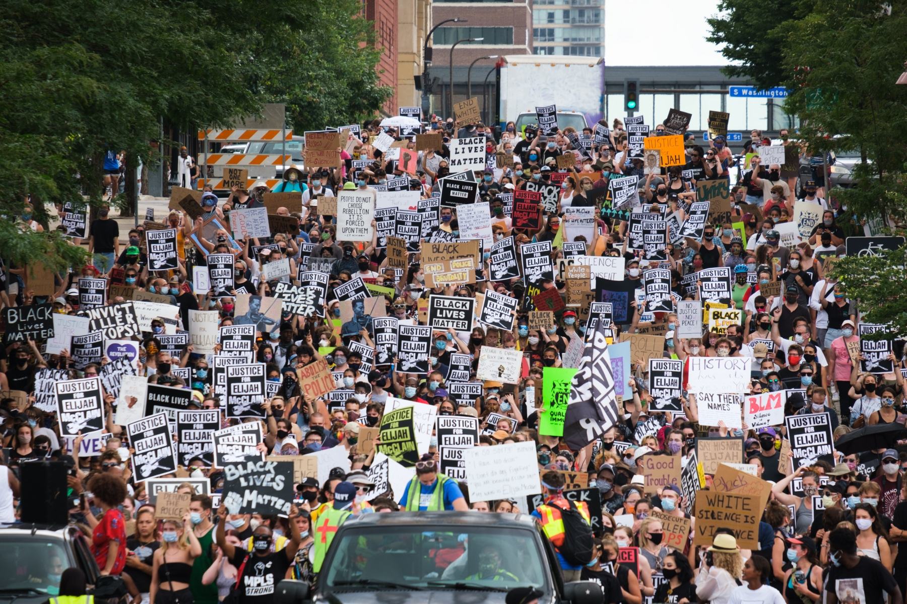 Hundreds of protestors march through Minneapolis on July 18, 2020 to protest the killing of Elijah McClain by police and first responders last August in Aurora, Colorado.