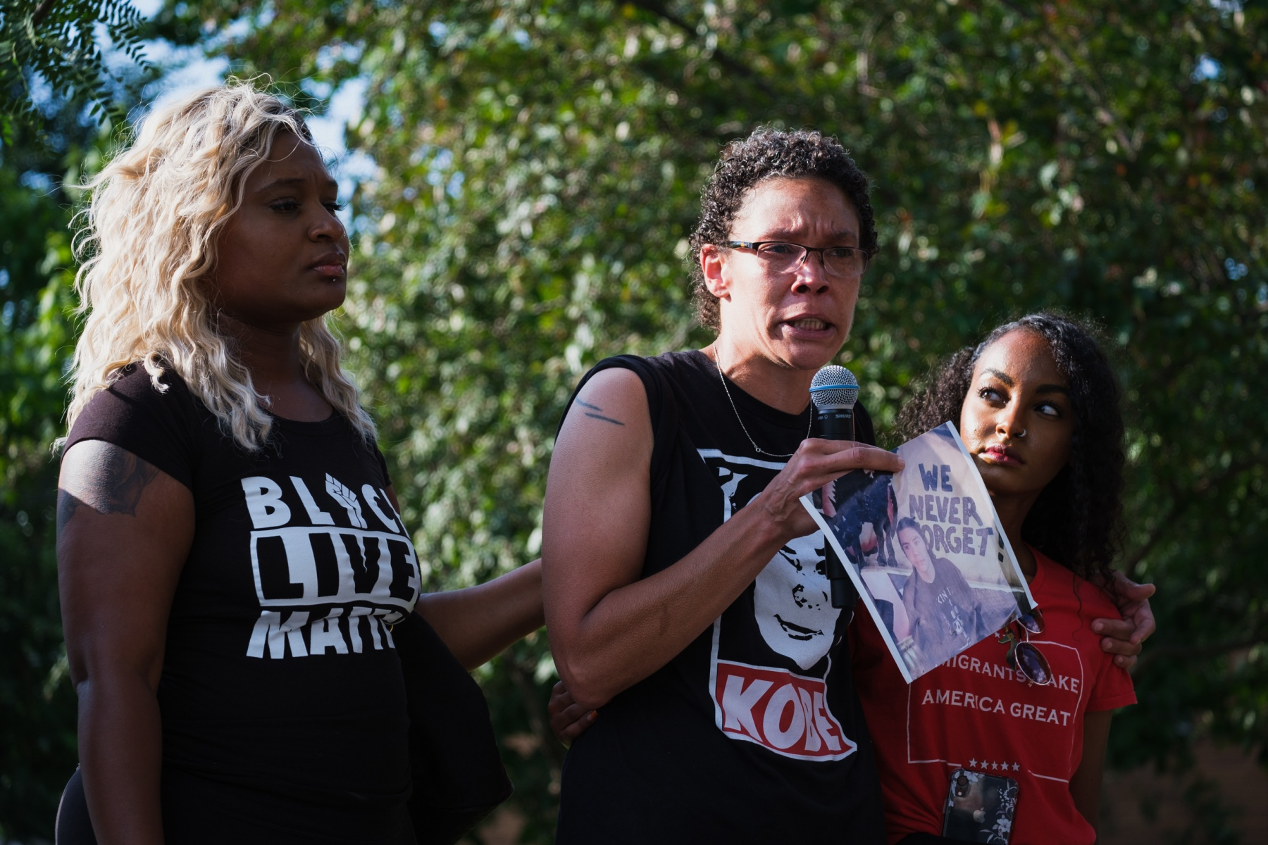 Toshira Garraway (left) and Sumaya Aden (right) support Amity Dimock (center) as she addresses a crowd gathered to remember the people whose killings by police were not filmed at Mueller Park in Minneapolis, Minnesota on July 24, 2020. Garraway's fiance, Justin Teigen, died after an encounter with the Saint Paul police in 2009. Dimock's son, Kobe Heisler, was shot and killed by Brooklyn Center police in 2019. Aden's brother, Isak, was shot and killed by Minneapolis police last year.