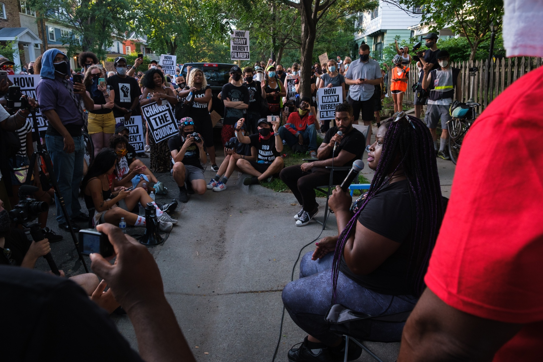 """Civil rights attorney Nekima Levy-Armstrong speaks at a de facto community forum held by racial justice organizers outside Minneapolis City Council President Lisa Bender's house on July 24, 2020. Levy-Armstrong and other longtime Twin Cities advocates against police brutality strongly criticized the city council's public commitment to """"end the Minneapolis Police Department"""", calling """"Defund the Police"""" an empty slogan meant to appease protestors without imposing concrete reform."""