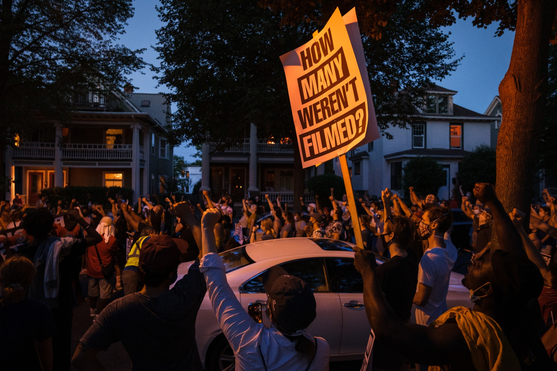 Hundreds of protestors raise their fists at a march in Minneapolis to demand for justice for the people whose killings by police were not filmed on July 24, 2020.