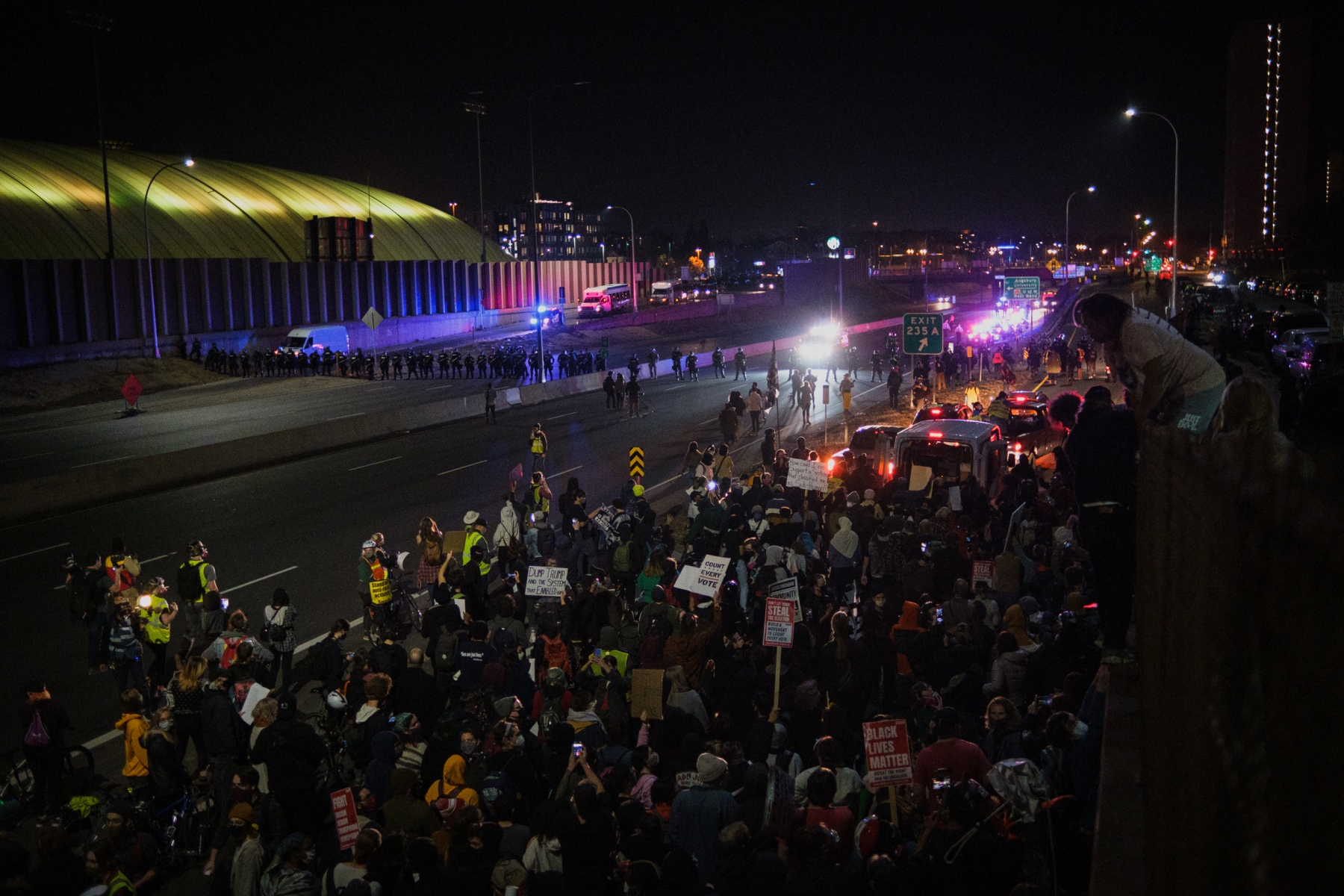 Minnesota state patrol officers surround and arrest hundreds of protestors marching down the highway to protest President Trump's baseless claims of voter fraud on November 4, 2020, the day after Election Day.