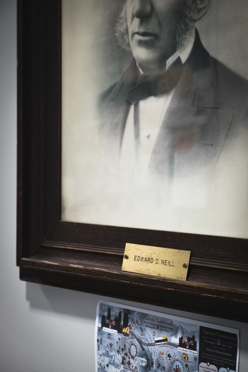 A portrait of Macalester College founder Edward D. Neill, a white supremacist who supported the oppression of Indigenous people and stole artifacts from sacred Dakota burial grounds, hangs at the entrance to the college's Neill Hall in Saint Paul, Minnesota on October 29, 2020. Below the portrait hangs a student illustration of Minneapolis and Saint Paul renamed in the Dakota language.
