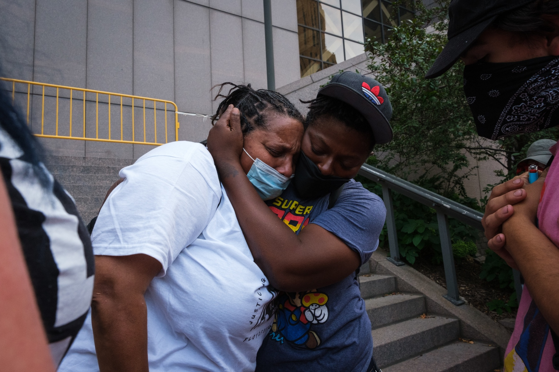 A Black Lives Matter protestor hugs Del Shea Perry, whose son died in a northern Minnesota jail after his complaints of bowel pains were ignored by jail staff, on the steps of Hennepin County Government Center in Minneapolis on August 24, 2020.