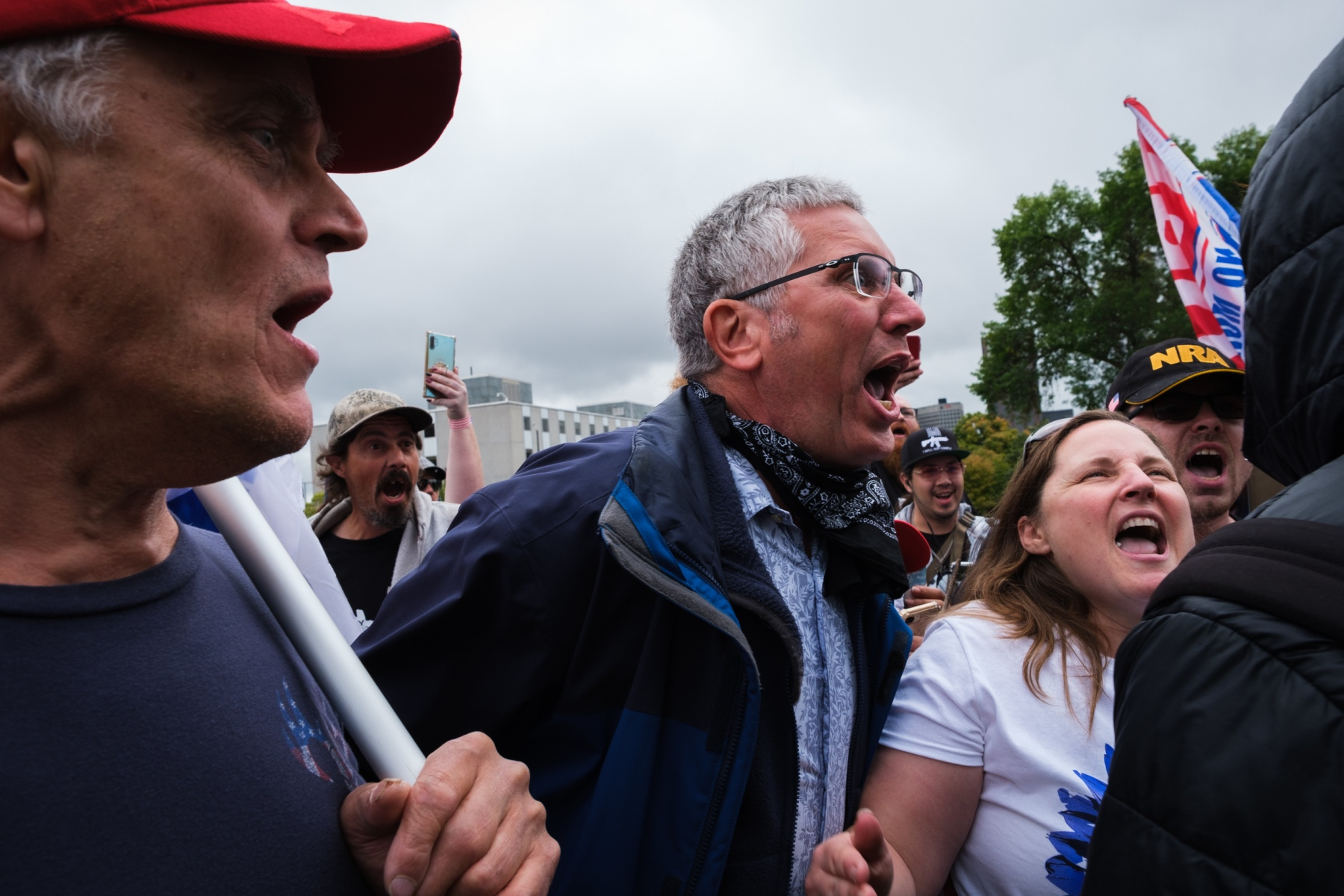 Trump supporters gathered to show support for the president and protest the state's coronavirus restrictions shout at a counterprotestor at the Minnesota state capitol in Saint Paul on September 12, 2020.