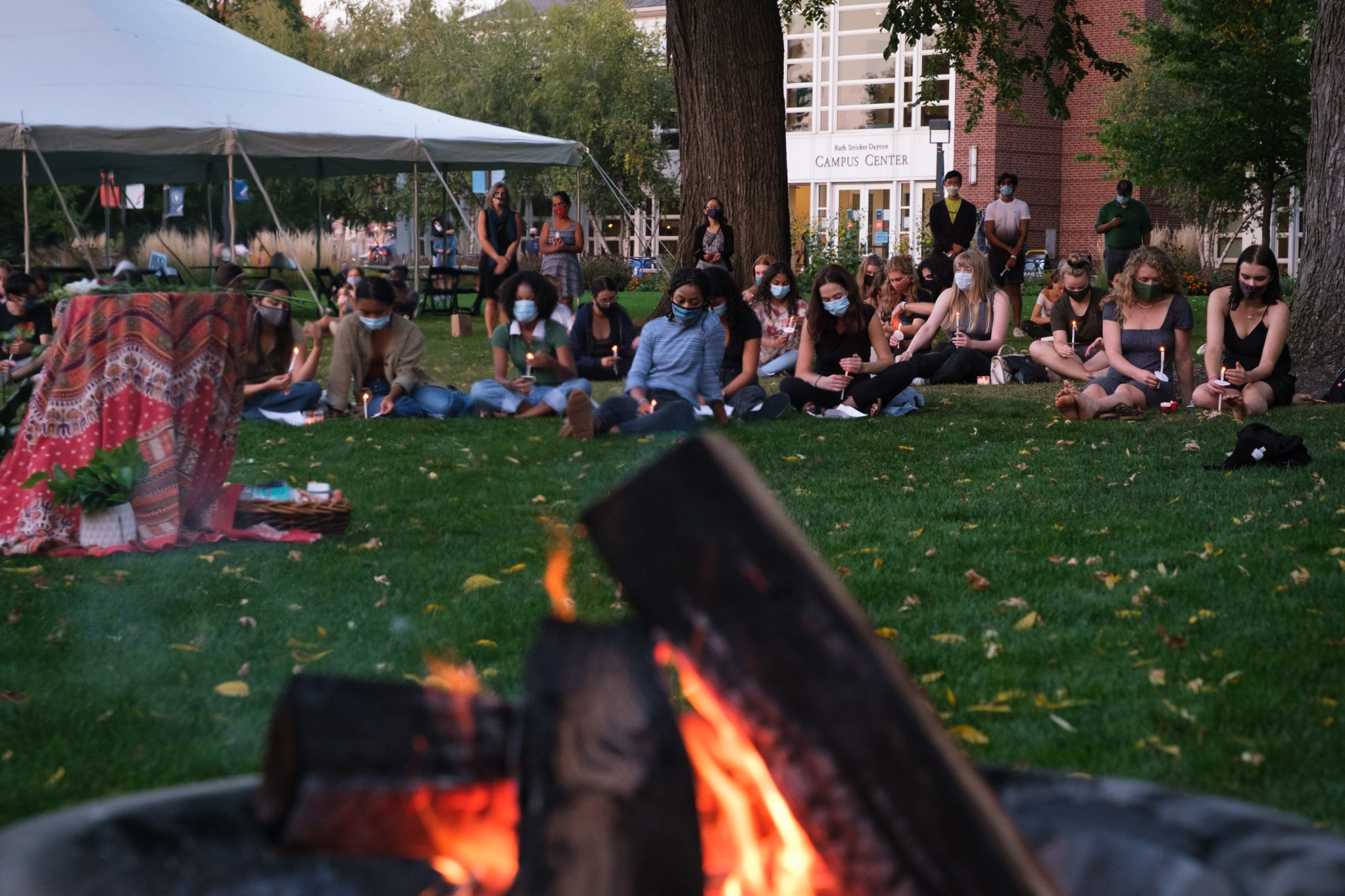 Students at Macalester College gather on the Great Lawn to hold a vigil for fellow student Kai Davis, who died by suicide the previous week, on September 25, 2020.