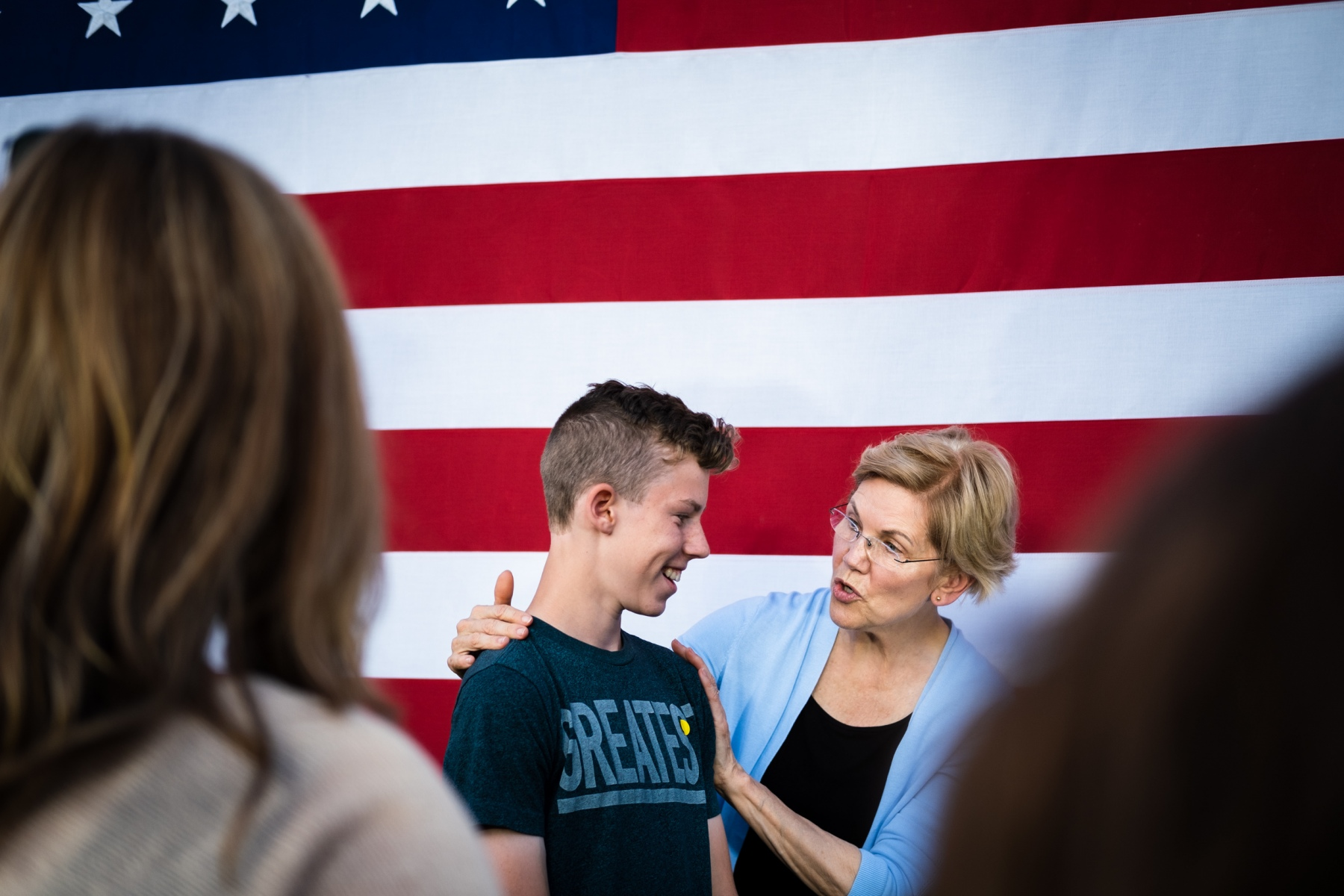Senator Warren speaks to a young supporter while taking selfies with the crowd after a preseidential campaign rally at Macalester College in Minnesota on August 19th, 2019.