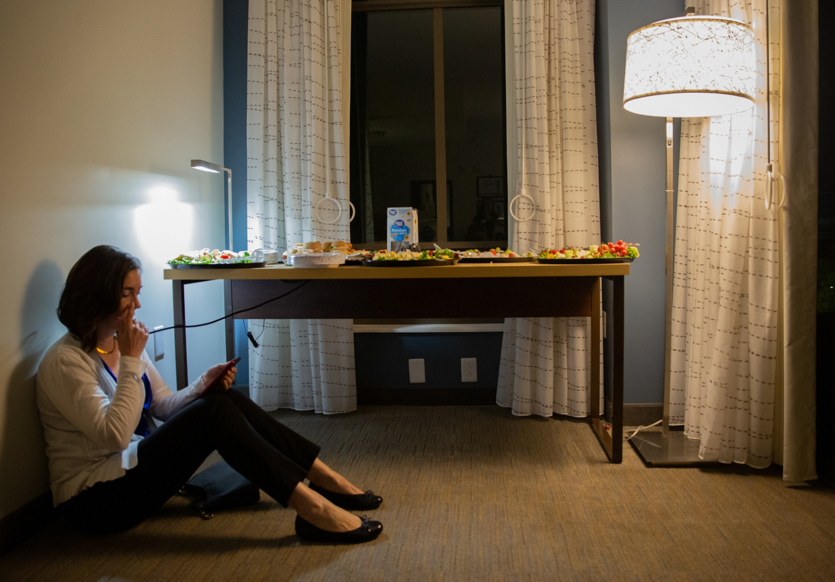 """On election day, Nov. 6th, Anita Earls, candidate for N.C. Supreme Court, sits alone in front of a food table before her """"war room"""" party at a hotel in downtown Raleigh.  The rest of her campaign staff are taking up the rest of the chairs in the suite doing work.""""I'm really nervous. I have no clue what I'm supposed to be doing right now. I have no idea how this works,"""" Earls says. """"Am I supposed to call my opponent if I win? What is that timing like? Do I wait for her to call me? How long? What if she wins? I'm really in the dark here. I'm really not a politician.""""  Anita Earls won the race that night and became the 100th justice of the N.C. Supreme Court."""